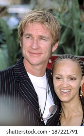 Matthew Modine and wife Cari at premiere of SIGNS, NY 7/29/2002