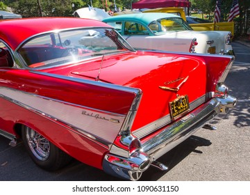 MATTHEWS, NC (USA) - May, 12, 2018: 1956 and 1957 Chevy automobiles on display at the Cruisin' Car Show, part of the Matthews Beach Fest community festival.