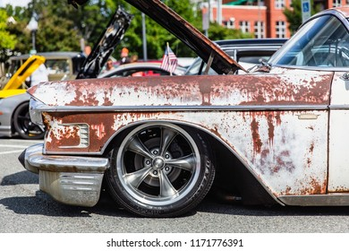 MATTHEWS, NORTH CAROLINA - SEPTEMBER 3 2018: Close up detail of a rusted Cadillac parked on display at the Matthews Auto Reunion