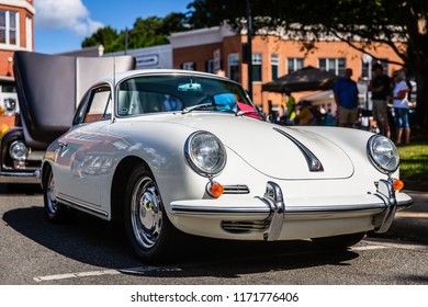 MATTHEWS, NORTH CAROLINA - SEPTEMBER 3 2018: Attendees admire a restored classic Porsche at the Matthews Auto Reunion