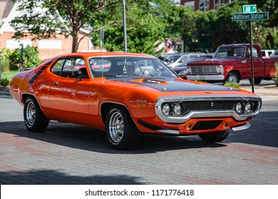 MATTHEWS, NORTH CAROLINA - SEPTEMBER 3 2018: A restored classic Plymouth Road Runner arrives at the Matthews Auto Reunion