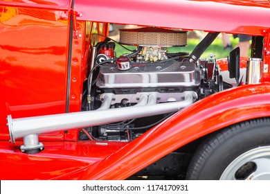 Matthews, North Carolina -  September 3, 2018: Close up of a shiny chrome Chervolet engine in a hot rod autombile parked on display at the Matthews Auto Reunion