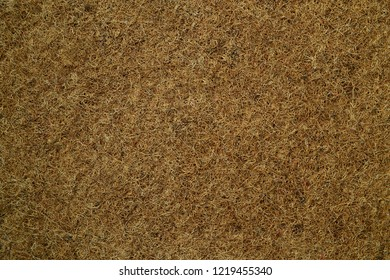 Mattress with organic coconut fiber. Grated coconut shell for the production of mattresses. Coir pressed at the factory. Background of fiber.