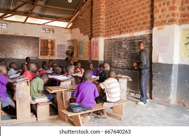 MATUGGA, UGANDA, AFRICA - SUMMER 2016: Unidentified children reading out loud what the teacher dictates.