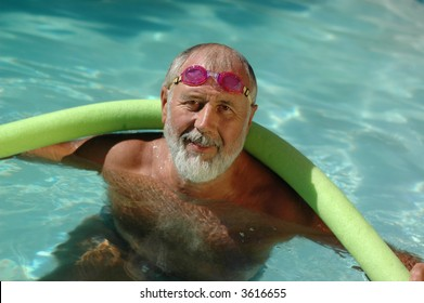 Mature active man getting a workout at the swimming pool