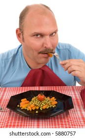 Mature adult man eating from his plate of healthy vegetables