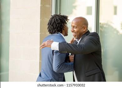 Mature African American businessman mentoring a younger man.