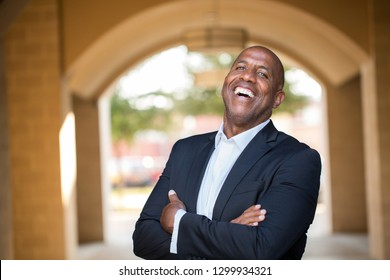 Mature African American Businessman smiling.