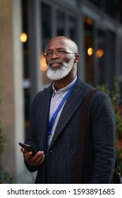 Mature african american businessman smiling confident holding smartphone in city