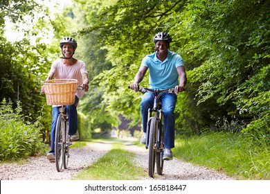 Mature African American Couple On Cycle Ride In Countryside