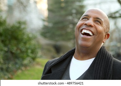 Mature African American man outside in a fall setting.