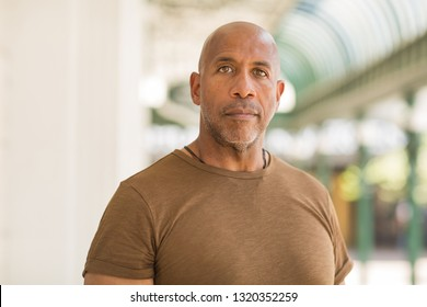 Mature African American man wearing glasses.