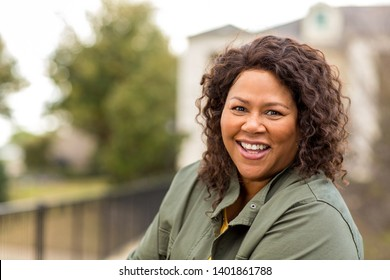 Mature African American woman smiling.