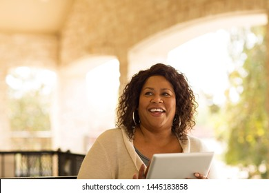 Mature African American woman working on a tablet.