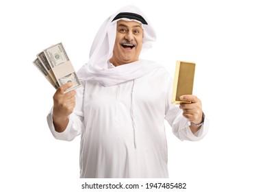Mature arab man holding a gold ingot and money isolated on white background