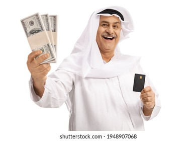 Mature arab man holding stacks of money and a credit card isolated on white background