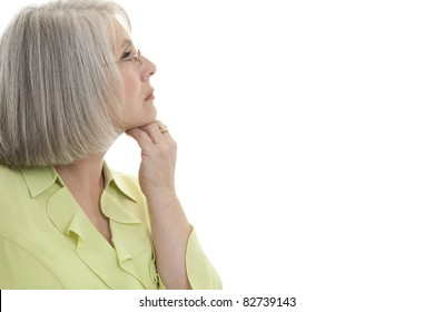 Mature, attractive Caucasian woman looking off into the distance.