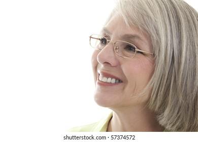 Mature, attractive Caucasian woman smiles at the camera