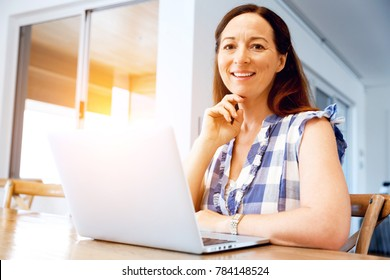 Mature beautiful woman working on her laptop
