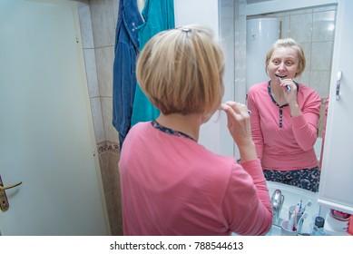 Blond mature bathroom