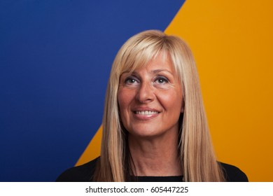 Mature blonde woman portrait on colorful background