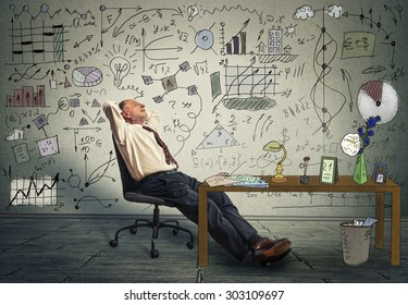 Mature business man relaxing at his desk in his office