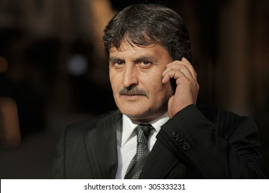 Mature business man talking with a mobile phone