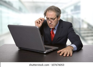 mature business man working with his laptop