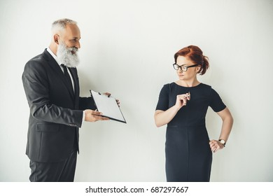 mature business partners with contract on white background
