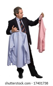 mature businessman choosing between two shirts, on white