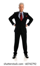 Mature businessman with hands on hips standing over white background