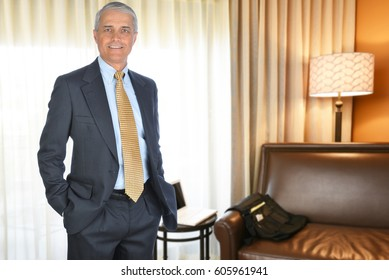 A mature businessman in a hotel room. Business travel concept.