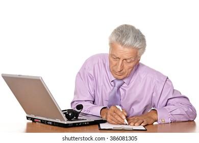 Mature businessman with laptop