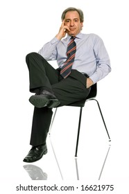 mature businessman on a chair, isolated on white