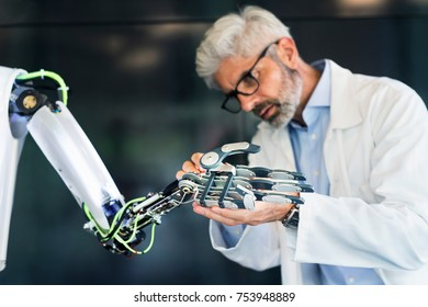Mature businessman or a scientist with gray hair with a robot.