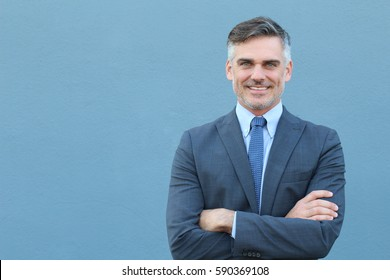 Mature businessman smiling wearing classic suit