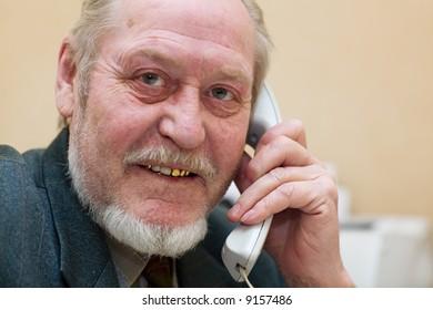 Mature businessman talking on the phone,