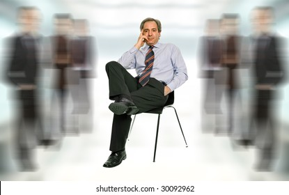 mature businessman thinking, seated on a chair