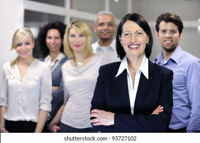 mature businesswoman and business team at office