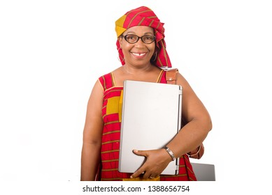 mature businesswoman standing on white background smiling with laptop in hand.