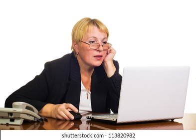 Mature businesswoman working with laptop on her workplace. Isolated against white background.