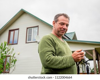 Mature caucasian man with camera