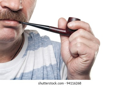 mature caucasian man holding smoking pipe in hand isolated on white background