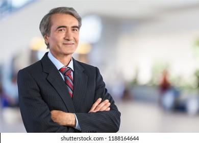 Mature confident Businessman on background