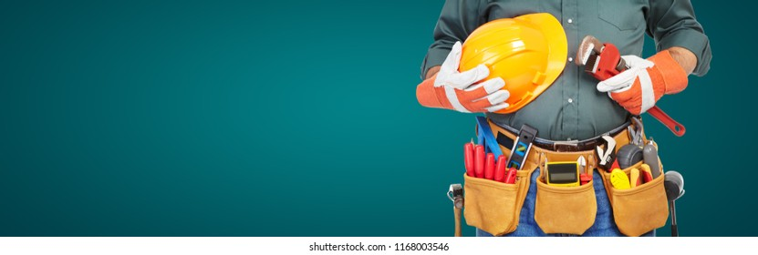 Mature contractor working. Over green background. Worker