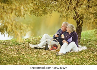 Mature couple in the autumn park