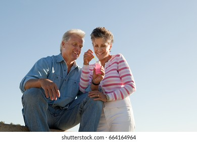 Mature couple with bubbles