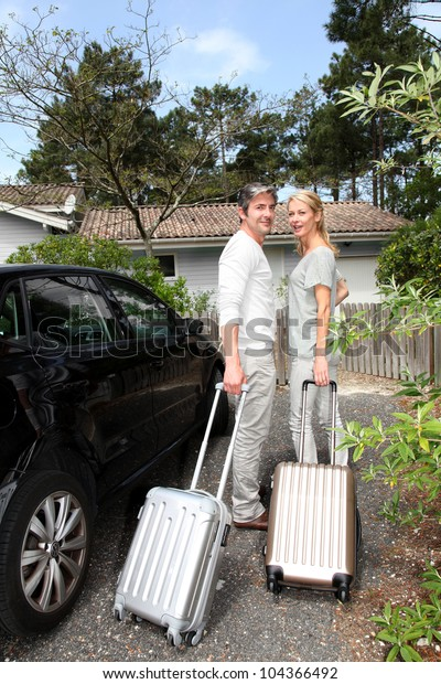 Mature couple coming back home from travel