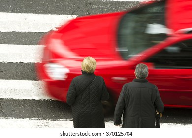 mature couple  in dangerous situation in  crosswalk  with traffic lights in street city