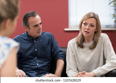 Mature Couple Discussing Problems With Relationship Counselor